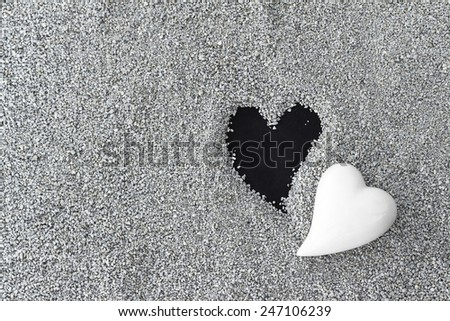 Black and white hearts, loss, death - stock photo