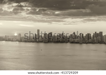 Black and white helicopter view of Miami Beach at sunset. - stock photo