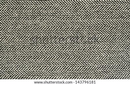 Black and white herringbone fabric - stock photo