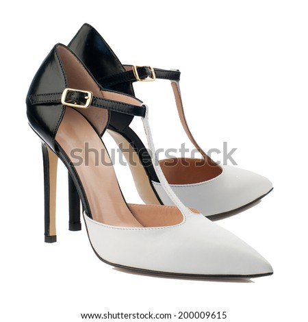 Black and white high heel women shoe isolated on white background. - stock photo