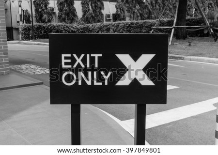 Black and white horizontal Exit Only traffic sign - stock photo