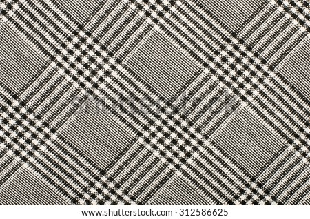 Black and white houndstooth pattern in squares. Black and white wool twill pattern. Woven dogstooth check design as background. - stock photo