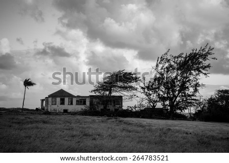 Black and white house on a windy hill