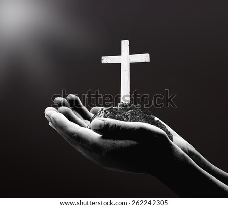 Black and white human hand holding the wooden white cross. Christmas background, Worship, Forgiveness, Mercy, Humble, Repentance, Reconcile, Adoration, Glorify concept. - stock photo