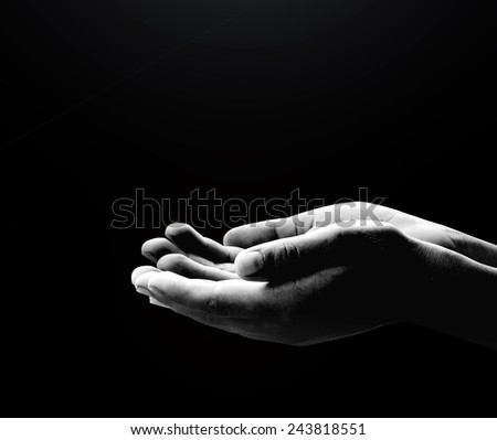 Black and white human hands of prayer
