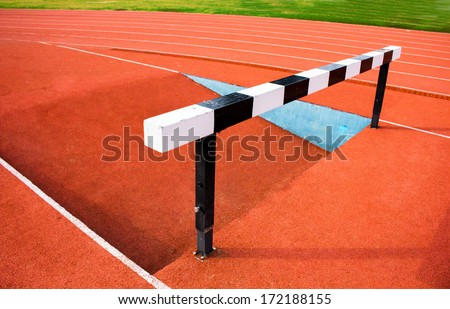 Black and white hurdles  - stock photo