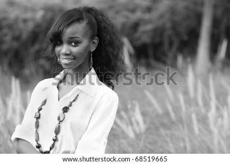 Black and white image of a beautiful young black woman - stock photo