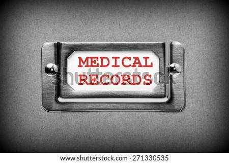 Black and white image of a desk drawer,cardboard box or storage container label with the title Medical Records in red ink on a white index card - stock photo