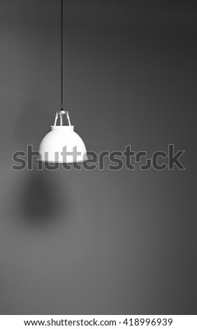 Black and white image of a hanging lamp. - stock photo