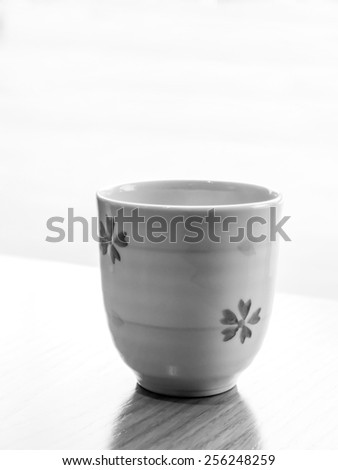 black and white image of a Japanese tea cup - stock photo