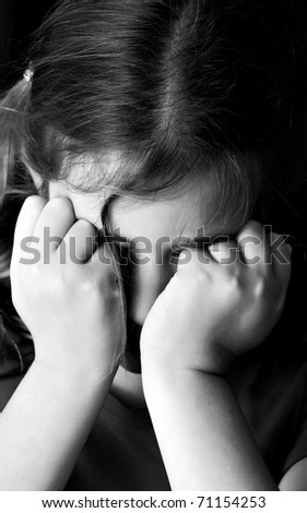 Black and white image of a little girl crying