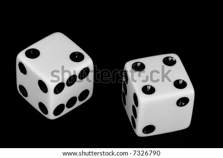 Black and white image of a pair of dice thrown with the number six