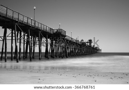 Black and White image of a pier  - stock photo