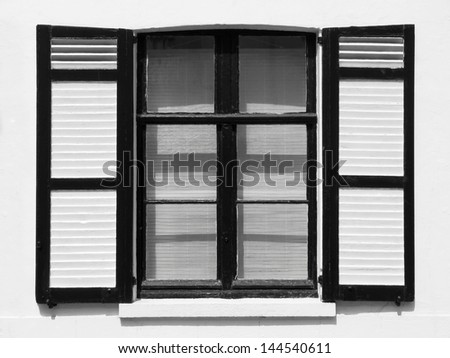 Black and white image of a rustic window - stock photo