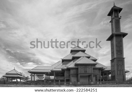 Black and white image of a traditional wooden mosque in Malaysia  - stock photo