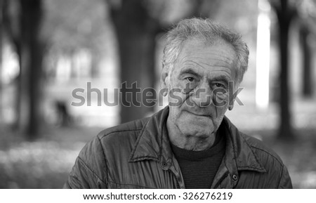 Black and white image of a wise old man - stock photo