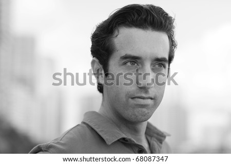 Black and white image of a young man looking away from the camera - stock photo