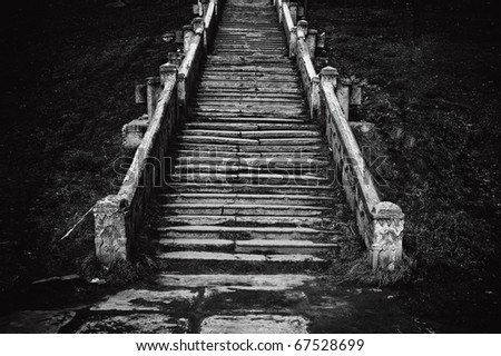 Black and white image of an old church staircase - stock photo