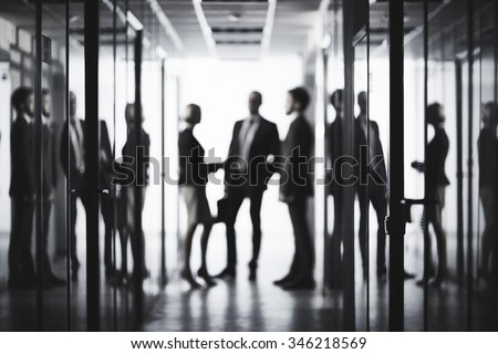 Black and white image of business people at office - stock photo
