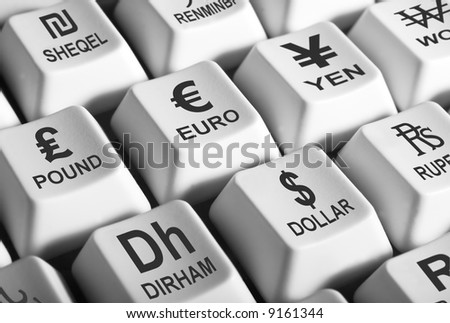 Black and white image of computer keys showing world's major curencies - stock photo