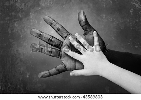Black and White image of hands on a grunge background - stock photo