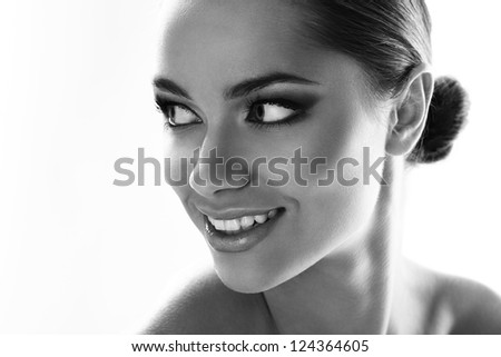 Black and white image of latino woman smiling isolated on white background - stock photo