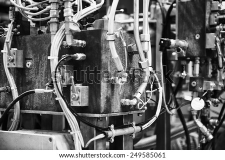 Black and White image of machine part on factory - stock photo