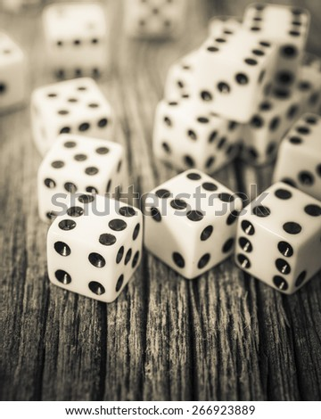 Black and white image of multiple dice. - stock photo