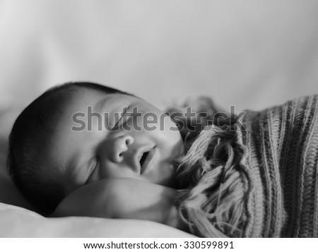 Black and White Image of Newborn Baby - stock photo