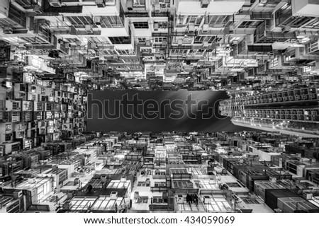 Black and white image of old dense building at hong kong - stock photo