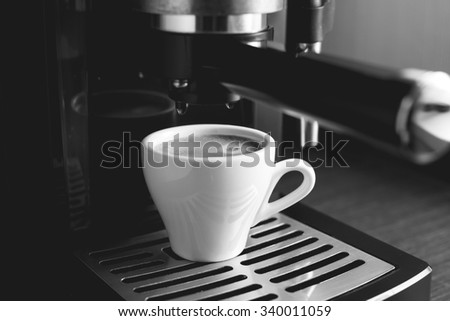 Black and white image of preparing espresso in coffee machine