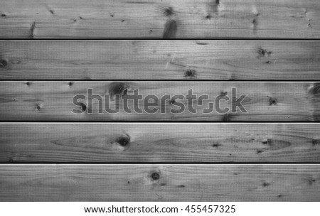 black and white image of raw wooden background  - stock photo