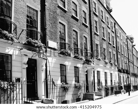 Black and white image of Regency Georgian terraced town houses in Westminster, London ,England - stock photo
