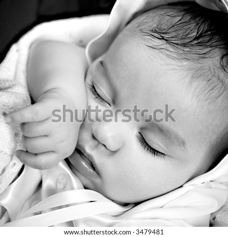Black and White image of resting baby boy - stock photo