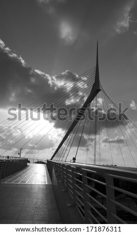 Black and White Image of Santiago Calatrava  Skywalk pedestrian bridge. Israel - Petach-Tikwa  - stock photo