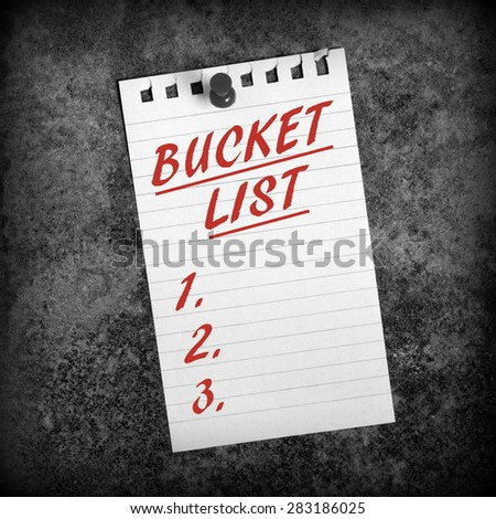 Black and White image of  sheet of lined paper with red text in the form of a Bucket List with blank spaces for goals to be entered - stock photo