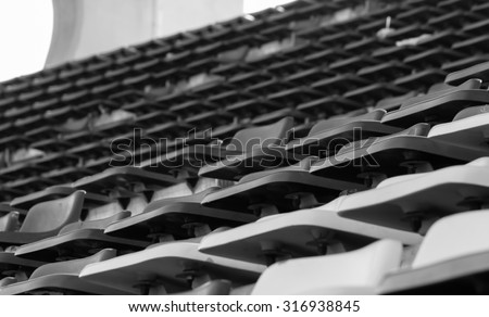 black and white image of sport stadium seats stand with single focus