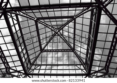 Black and white image of the glass roof of a mall - stock photo