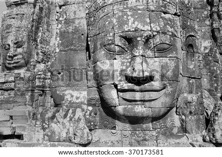 Black and white image of the head of a bodhisattva at the Bayon Temple in Cambodia.