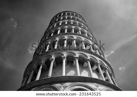 Black and white image of the Leaning Tower of Pisa and Statue - stock photo