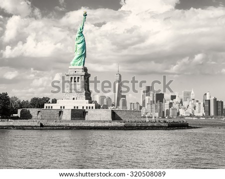 Black and white image of the New York skyline with the Statue of Liberty in color - stock photo
