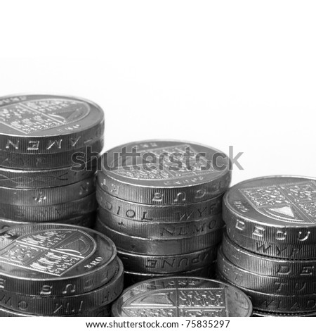 Black and white image of UK coins over white