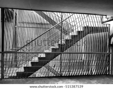 Black and white image of underground staircases with the light from surface