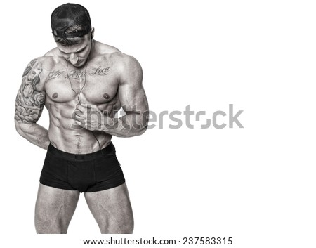 Black and white image of whortless man in black cup who is listening music - stock photo