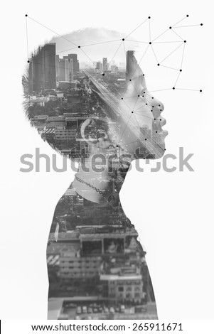 Black and white image the boy with cityscape background (Conceptual Surreal Style) - stock photo