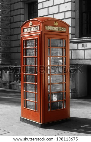 Black and white image with a color London phone box  - stock photo