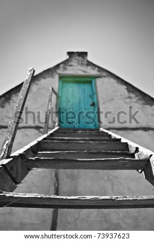 Black and white image with green door in color - very shallow depth of field - stock photo