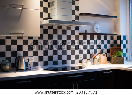 Black and white interior of a modern kitchen, close-up - stock photo