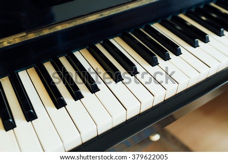 black and white keys of the piano perspective side - stock photo