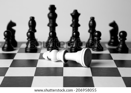 Black and white king on a chess board - stock photo